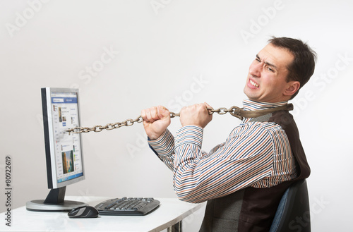 Man chained to his computer Poster
