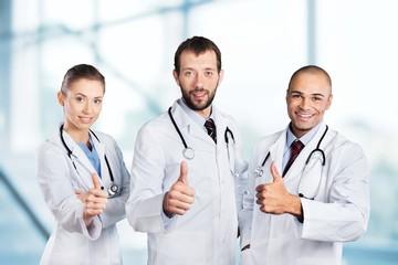 Doctor. Portrait of happy doctors standing in a row