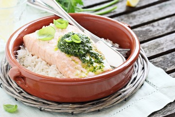 Steamed salmon with pesto and rice garnish.Selective focus.