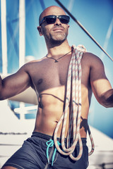 Handsome man on sailboat