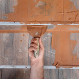 Construction site joint sealing tiles worker hand and trowel