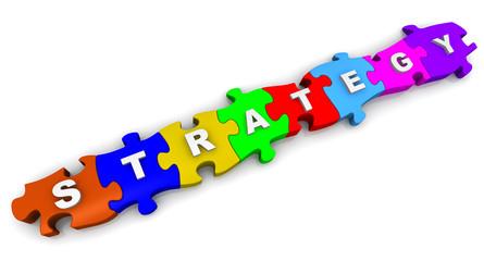 Стратегия (Strategy). Надпись на разноцветных пазлах