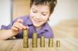 Leinwanddruck Bild - Boy puts the coin