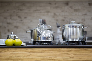 stainless utensils on gas cooker and apples