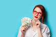 Leinwanddruck Bild - women in red glasses with money