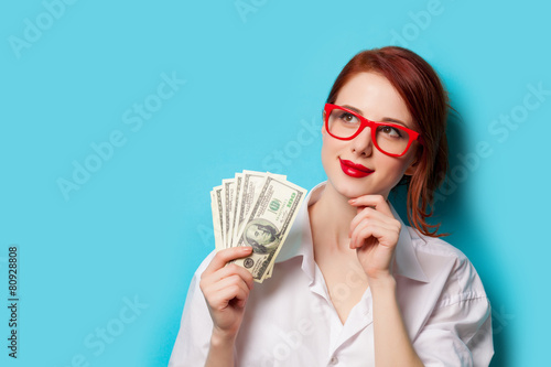 Leinwanddruck Bild women in red glasses with money