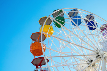 Detail of a colorful ferris wheel seen at a fair
