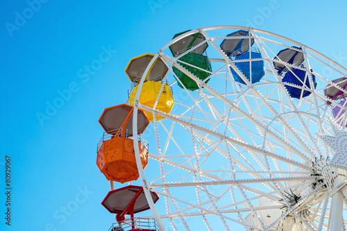 Detail of a colorful ferris wheel seen at a fair - 80929067