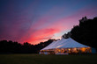 An event tent at night with a sunset during a wedding - 80932603