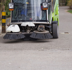 SWEEPER CAR IN A CITY PARK ,CLEANING