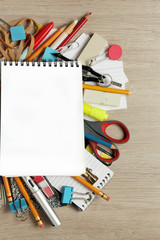 Blank paper on lots of office supplies