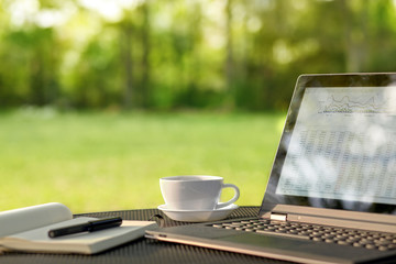 Laptop and coffee in outdoor office
