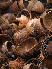 Textured background of stack of hairy brown coconuts