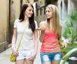 women taking walk in city at summer day