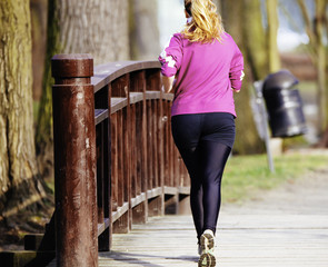 Sized woman jogging in park