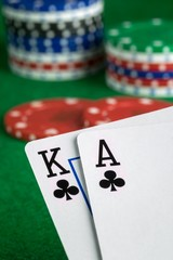 A poker hand of ace king of spades with chips in background
