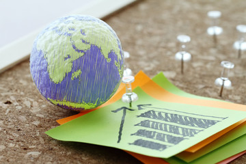 hand drawn texture globe with pin and business graph sticky note