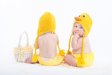 Two babies in chicken costumes with white basket