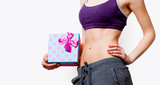 Woman showing her abs with gift box