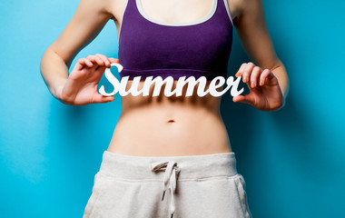Woman showing her abs with Summer word inscription