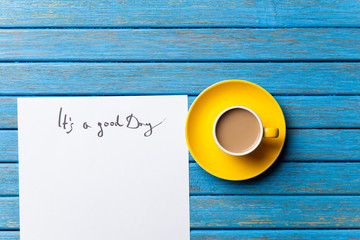 coffee and paper with Good day inscription
