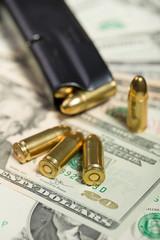 bullet on US dollar banknotes