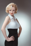 Pin-up girl young and beautiful woman portrait on gray