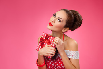 Excited Woman Holding Gift Box. Pin-up retro style.