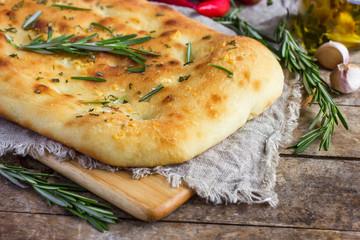 Italian focaccia bread with rosemary and garlic