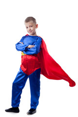 Image of cute boy posing in Superman costume