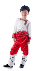 Funny blonde boy posing in rustic costume