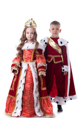 Cute brother and sister posing in royal attire