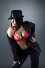 Hot busty brunette posing in costume for dancing