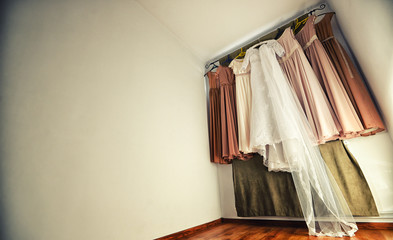 Hanging wedding dress and bridesmaid dresses