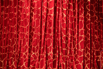 Red curtain with white pattern