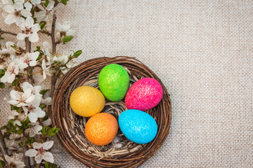 Decorative easter eggs in a nest with flowers