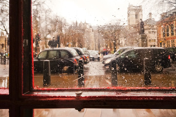 Traffic jam in the rainy day from traditional red telephone box