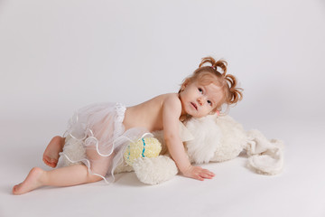Happy baby playing with stuffed toy animal