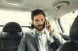 Casual business man on mobile phone in rear of the car - 80954841