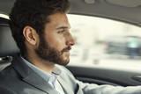 Fototapety Man driving car. Driver businessman