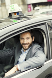 Fototapety Portrait of French Parisian taxi driver. Looking at camera