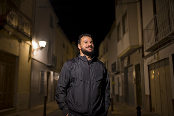 Outdoors night hipster in tracksuit
