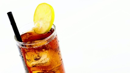 fresh coke with lime slice and ice cubes isolated on white