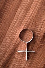 Female gender symbol venus on wooden background.