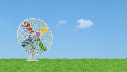 Colorful electric fan on grass