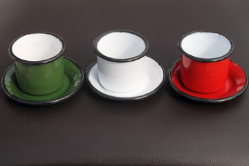three small cups in colors of Italy:green and white and red