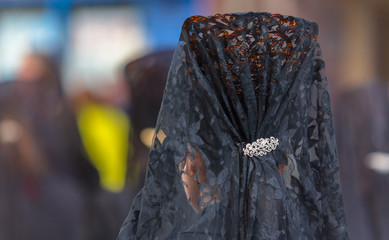 Back side of a woman with a comb during Holy Week