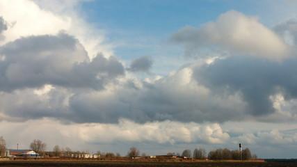Farmland under blue cloudy sky