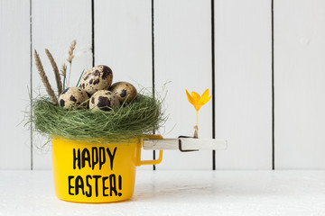Easter Decoration - Yellow Cup with Quail Eggs in a Nest on Top