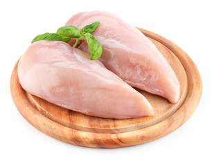 Raw chicken fillets on wooden board isolated on white